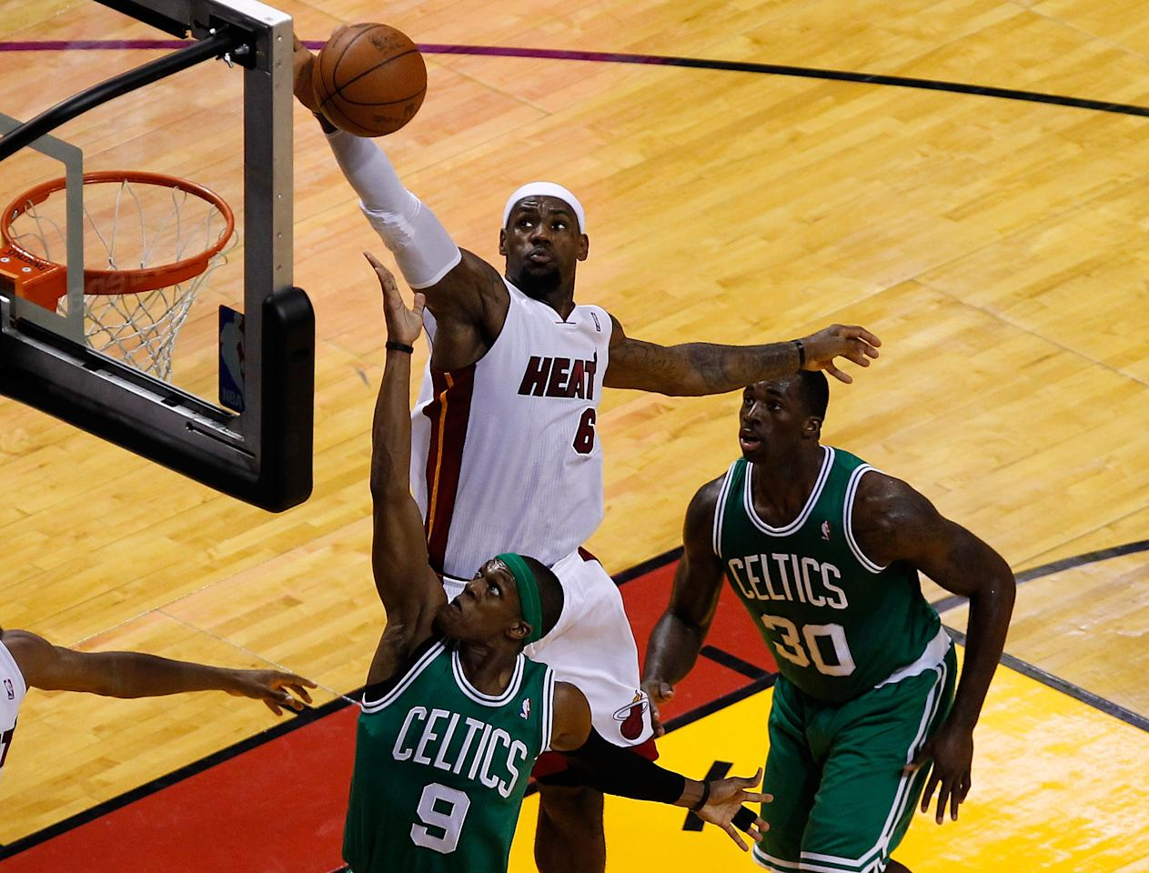 MIAMI, FL - JUNE 09:  LeBron James #6 of the Miami Heat blocks the shot of Rajon Rondo #9 of the Boston Celtics in the first half in Game Seven of the Eastern Conference Finals in the 2012 NBA Playoffs on June 9, 2012 at American Airlines Arena in Miami, Florida. NOTE TO USER: User expressly acknowledges and agrees that, by downloading and or using this photograph, User is consenting to the terms and conditions of the Getty Images License Agreement.  (Photo by J. Meric/Getty Images)
