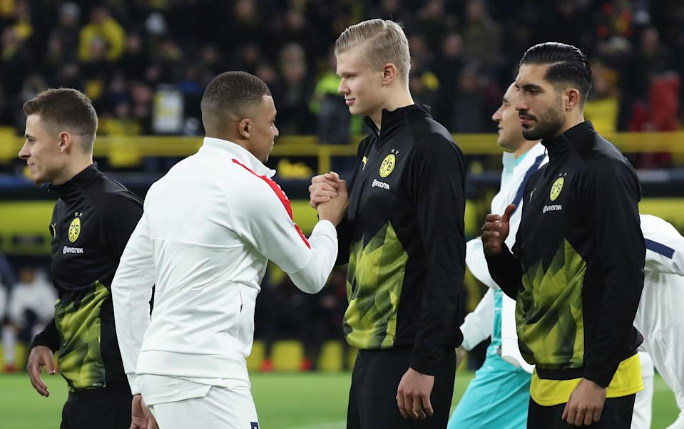 DORTMUND, GERMANY - FEBRUARY 18: Kilian Mbappe of Paris Saint-Germain shakes hands with Erling Haaland of Dortmund prior to the UEFA Champions League round of 16 first leg match between Borussia Dortmund and Paris Saint-Germain at Signal Iduna Park on February 18, 2020 in Dortmund, Germany. (Photo by Alex Grimm/Getty Images)