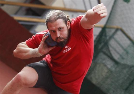 Shot putter Tomasz Majewski of Poland trains for the 2012 London Olympic Games at the Academy of Physical Education in Warsaw April 17, 2012. Majewski won a gold medal at the 2008 Beijing Olympic Games with 21.51 meters and is considered as one of the favorites for the 2012 London Olympic Games this year.