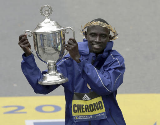 Lawrence Cherono, of Kenya, lifts the trophy after winning the 123rd Boston Marathon on Monday, April 15, 2019, in Boston. (AP Photo/Charles Krupa)