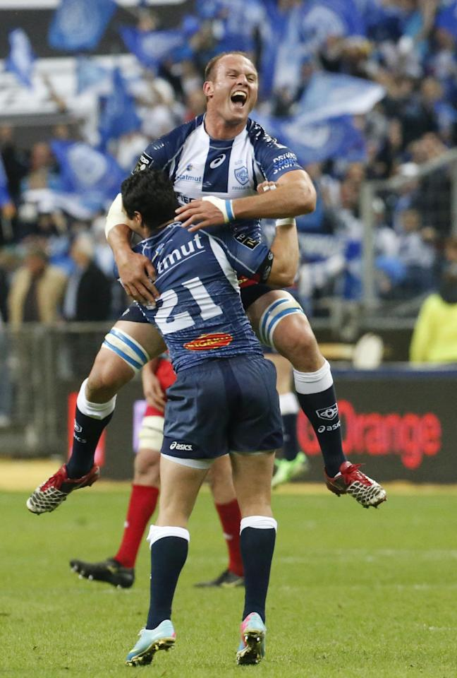 Jan de Bruin Bornman, top, celebrates with teammates Danirel Kirkpatrick of Castres Olympic rugby team celebrate their victory over Toulon during their Top 14 final rugby match at Stade de France stadium in Saint Denis, north of Paris, France, Saturday, June 1, 2013. (AP Photo/Jacques Brinon)