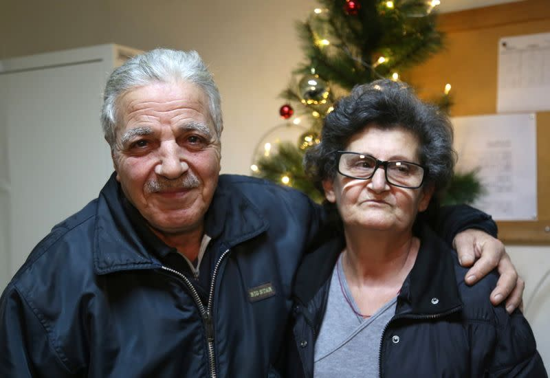 Georgette Suleiman, 63, who looks after a Beirut school damaged by Beirut port blast is pictured with her husband in Beirut