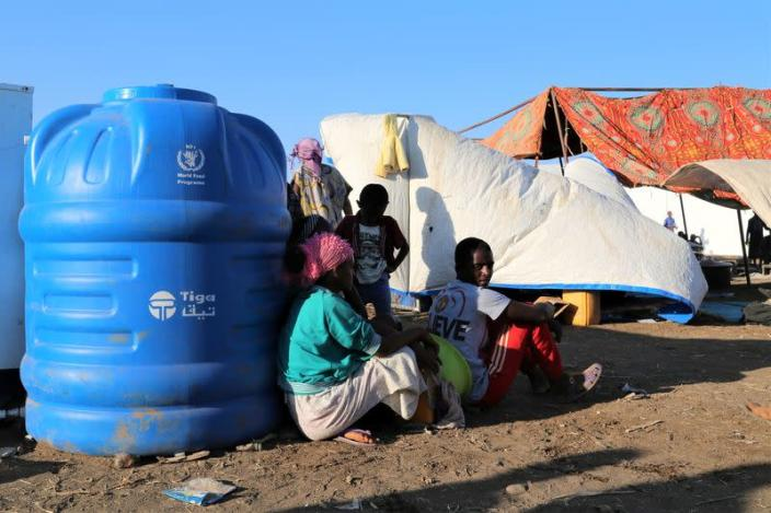 Ethiopians who fled the ongoing fighting in Tigray region, wait to be processed for emergency food and logistics support by the WFP in Hamdait village on the Sudan-Ethiopia border in eastern Kassala state