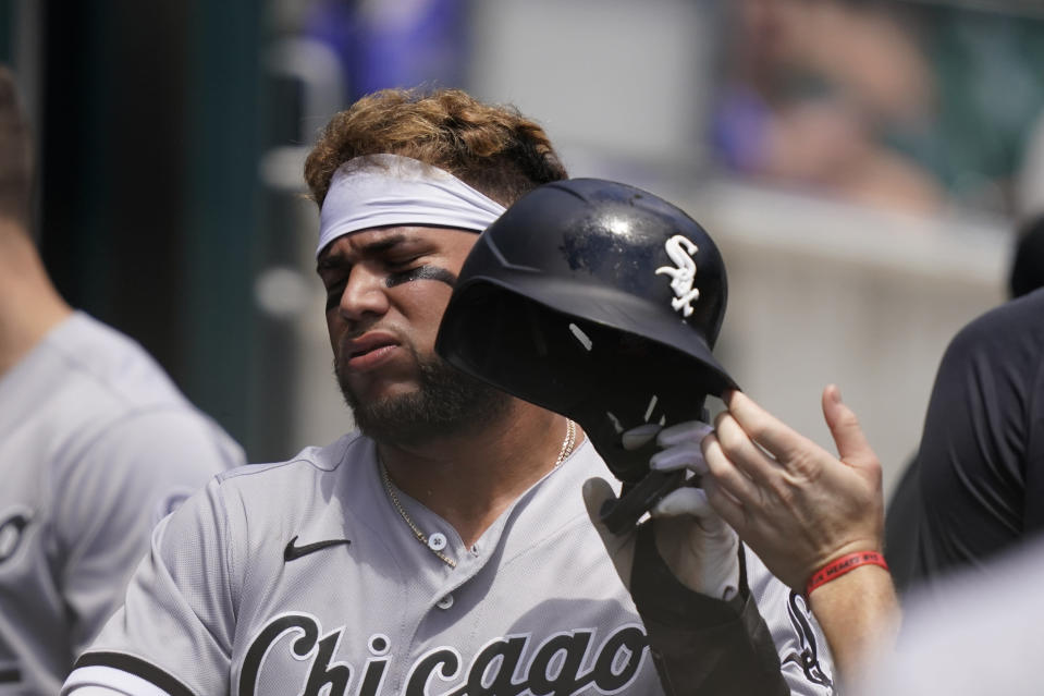 Chicago White Sox's Yoan Moncada walks into the dugout after scoring during the fourth inning of a baseball game against the Detroit Tigers, Sunday, June 13, 2021, in Detroit. (AP Photo/Carlos Osorio)