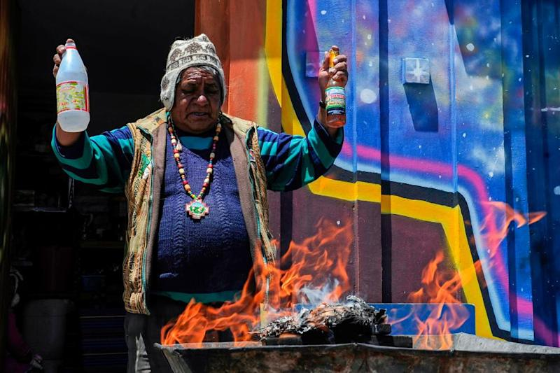 An Aymara priest, or yatiri, performs an Andean ritual to thank the Pachamama (Mother Earth) in El Alto, on 1 December 2019.