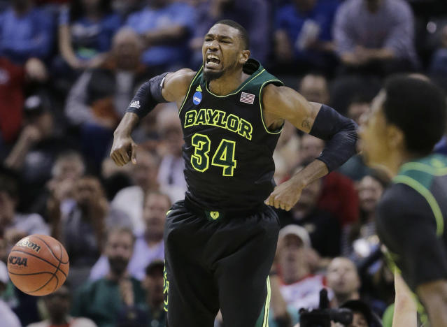 Baylor's Cory Jefferson (34) yells as he scores against Creighton during the second half of a third-round game in the NCAA college basketball tournament Sunday, March 23, 2014, in San Antonio. (AP Photo/Eric Gay)