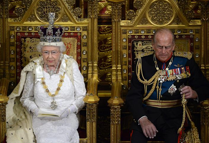 Britain's Queen Elizabeth sits with Prince Philip as she delivers her speech in the House of Lords, during the State Opening of Parliament at the Palace of Westminster in London  June 4, 2014.   REUTERS/Carl Court/Pool   (BRITAIN - Tags: ENTERTAINMENT POLITICS SOCIETY ROYALS)