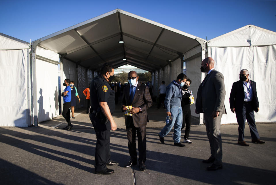 Houston Police Department Chief Art Acevedo and Houston Mayor Sylvester Turner talk by the new federally-supported and state-managed COVID-19 vaccination clinic tents at NRG Park, Monday, Feb. 22, 2021, in Houston. (Marie D. De Jesus/Houston Chronicle via AP)