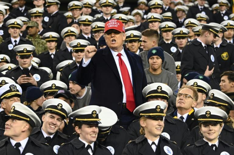 The US Army and Navy academies cleared  students who had been suspected of giving  hand signs associated with white supremacist groups during the annual Army-Navy football game, which was attended by President Donald Trump