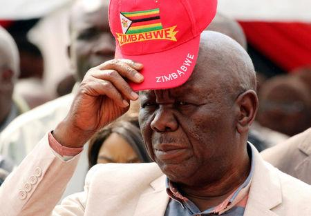 FILE PHOTO: Zimbabwe's opposition MDC leader Tsvangirai arrives at a rally in Harare