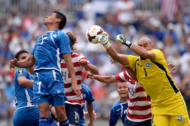 BALTIMORE, MD - JULY 21: Dagoberto Portillo Gamero #1 of El Salvador makes a save on a corner kick by Jose Torres #16 of the United States in the first half of the 2013 CONCACAF Gold Cup quarterfinal game at M&T Bank Stadium on July 21, 2013 in Baltimore, Maryland. (Photo by Patrick McDermott/Getty Images)