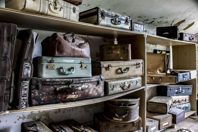 <p>More bags and suitcases. Many of the occupants lived in dormitory-like spaces, with limited privacy. (Caters News) </p>