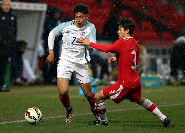 DONCASTER, ENGLAND - MARCH 27: Tyler Walker of England (L) challenged by Kadin Chung of Canada during the U20 International Friendly match between England and Canada at the Keepmoat Stadium on March 27, 2016 in Doncaster, England. (Photo by Nigel Roddis/Getty Images)