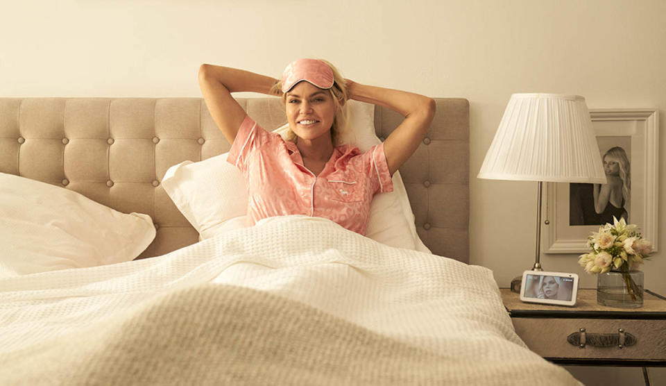 Sophie Monk in bed wearing pink pyjamas and a sleeping mask