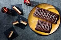 """Buttery pat-in-pan shortbread takes the place of mass-produced cookies and gets smothered with silken chocolate and from-scratch caramel in this giant-sized copycat of a favorite American candy bar. <a href=""""https://www.epicurious.com/recipes/food/views/giant-chocolate-caramel-cookie-bars?mbid=synd_yahoo_rss"""" rel=""""nofollow noopener"""" target=""""_blank"""" data-ylk=""""slk:See recipe."""" class=""""link rapid-noclick-resp"""">See recipe.</a>"""