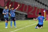 Japan's Ritsu Doan, left, and teammate Reo Hatate, second from left, celebrates a goal from Takefusa Kubo (7) during a men's soccer match against South Africa at the 2020 Summer Olympics, Thursday, July 22, 2021, in Tokyo, Japan. (AP Photo/Shuji Kajiyama)