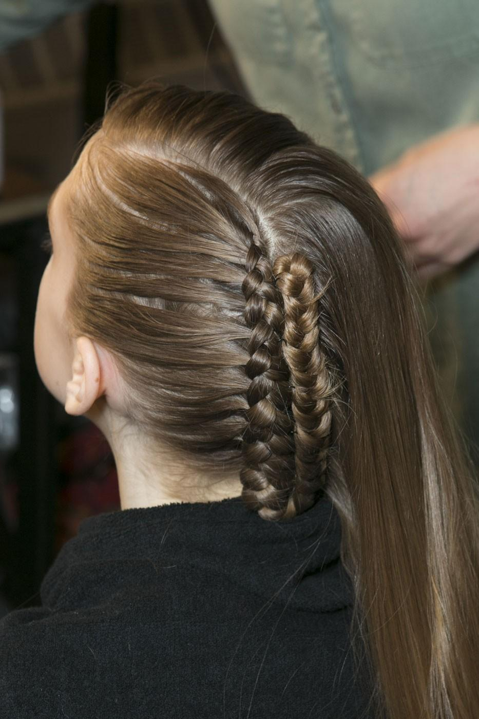 """<div class=""""caption-credit""""> Photo by: Stylecaster Pictures</div>At Alexandre Herchcovitch, braids were kept close to the head while half of the hair was kept free for a loose, side flow. <br>"""