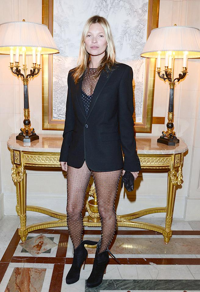 "<p class=""MsoNormal"">Kate Moss caused a commotion at Paris Fashion Week upon arriving at a star-studded soiree on Tuesday sans pants and makeup. Instead, the supermodel daringly donned a crystal-encrusted bodysuit and black blazer from the Saint Laurent Fall 2013 collection. What do you make of Moss' bold fashion statement? Tasteless or tempting? (3/5/2013)</p>"