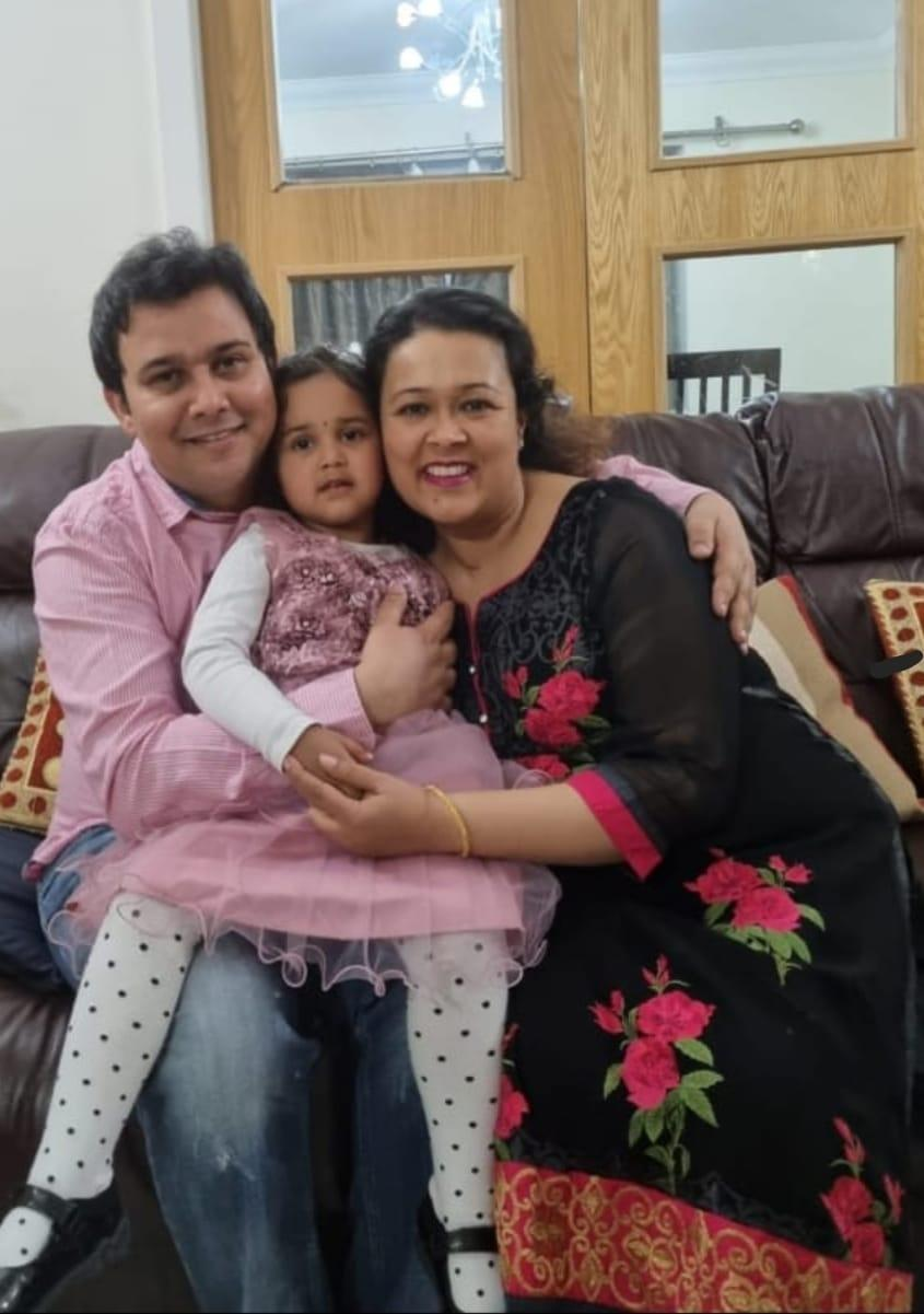 Now home, Dr Gupta's recovery is 'by no means complete'. She is pictured on her 41st birthday with her husband and their daughter in March 2021. (Supplied: Dr Anushua Gupta)