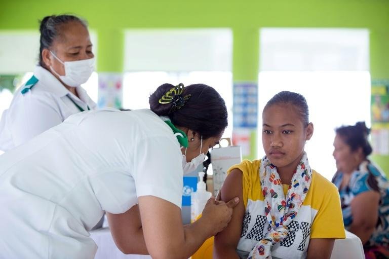 Samoa introduced mandatory vaccination as part of a state of emergency declared in November when the scale of infection sweeping through the 200,000-strong population became apparent (AFP Photo/ALLAN STEPHEN)