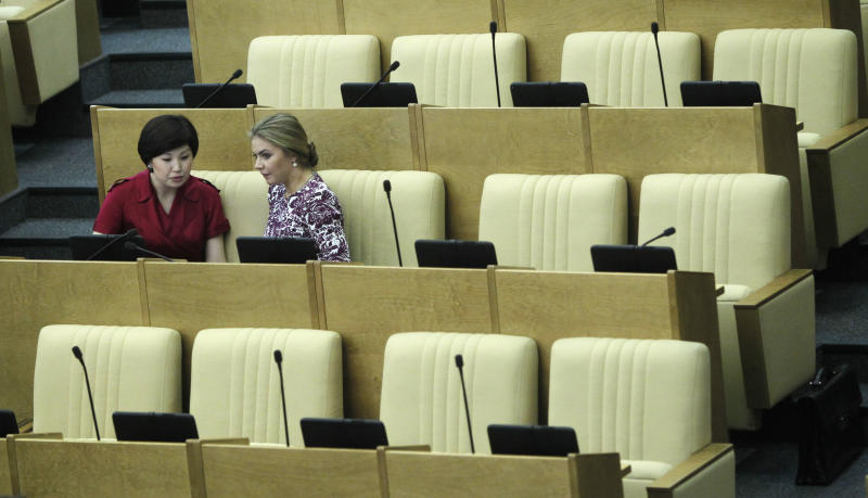 Members of the State Duma, lower parliament chamber, seen during a session in Moscow, Russia, Tuesday, July 10, 2012. Russia's parliament is due to ratify an agreement for Russia to join the World Trade Organization in a move that will push Moscow to open up its economy. (AP Photo/Misha Japaridze)
