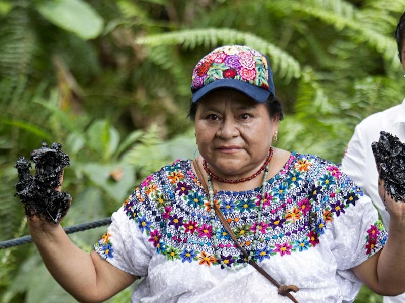 Nobel Peace Prize winner Rigoberta Menchu, an indigenous people's rights activist, shows her hands covered with oil during a protest in Lago Agrio in Ecuador near the site of oil exploration by Chevron's Texaco subsidiary: Reuters