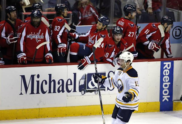 Buffalo Sabres center Cody Hodgson (19) celebrates his game-winning goal in front of the Washington Capitals bench after the shootout portion of an NHL hockey game, Sunday, Jan. 12, 2014, in Washington. The Sabres won 2-1. (AP Photo/Alex Brandon)