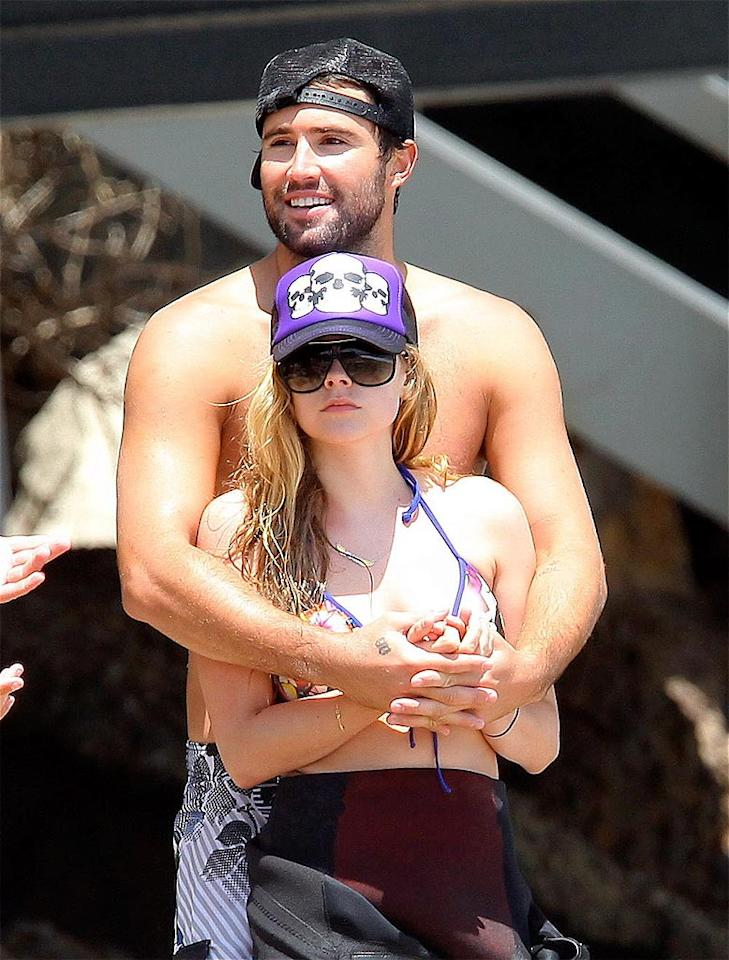 "Trucker hat-clad couple Brody Jenner and Avril Lavigne got close while surfing. Photogs even caught a glimpse of the tattoos the reality TV star and singer have of each other's names! Sasha-Mariotto-DR/<a href=""http://www.x17online.com"" target=""new"">X17 Online</a> - July 4, 2010"