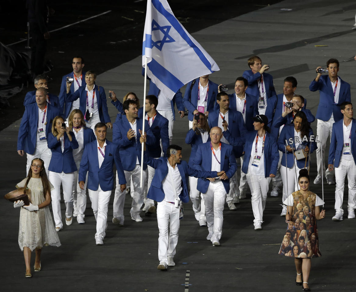Israel's Shahar Zubari carries the flag during the Opening Ceremony at the 2012 Summer Olympics, Friday, July 27, 2012, in London. (AP Photo/Paul Sancya)