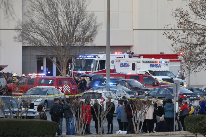 Bystanders watch as police clear Penn Square Mall following a shooting Thursday, Dec. 19, 2019, in Oklahoma City. One person was shot at the mall during what police are calling a disturbance involving two people. (AP Photo/Sue Ogrocki)
