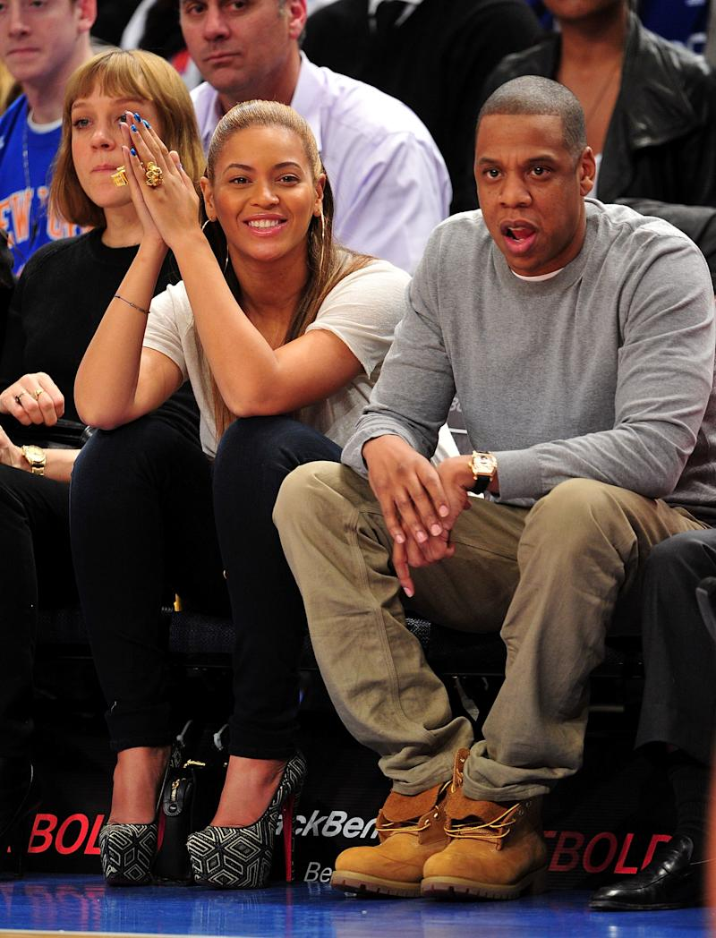 Wearing a simple tee and jeans, Beyonce looked surprisingly understated while attending a New Jersey Nets v New York Knicks game at Madison Square Garden with Jay Z... until you look at her feet. Those, ladies and gentleman, are Christian Louboutins. And they are anything but casual footwear.