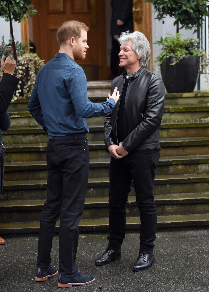 Prince Harry, Duke of Sussex and Jon Bon Jovi have a discussion outside Abbey Road Studios on February 28, 2020 in London, England.