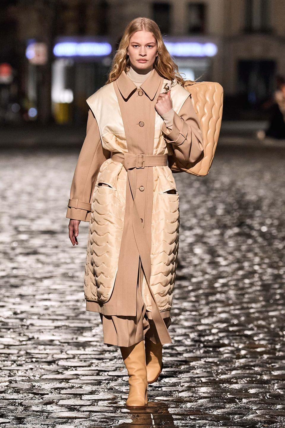 "<p>Gabriela Hearst presented her debut collection as creative director of Chloé on the streets of Paris on the centennial anniversary of founder Gaby Aghion's birth. </p><p>""From Gaby to Gabi, two ambitious women interpreting femininity in the context of their time,"" described the show notes. ""And from Gabi to Gaby, the reassurance that, 'Your House is in good hands.'""</p><p>To Hearst, the meaning of Chloé – 'blooming' in Greek – resonated strongly in terms of working towards the greater good and improving on the sustainability credentials of the fashion house. This was clear to see not just in the designs –""in every piece, a sense of purpose"" – but also in the new timeline of sustainability objectives in place, with this first collection already four times more sustainable than the one presented this time last year. The changes include: eliminating virgin synthetic fibre (polyester) or artificial cellulosic fibre (viscose) and sourcing recycled, reused and organic denim. More than 50 per cent of silk comes from organic agriculture and more than 80 per cent of cashmere yarn for knitwear is recycled, while the bags are lined in natural linen.<br></p>"