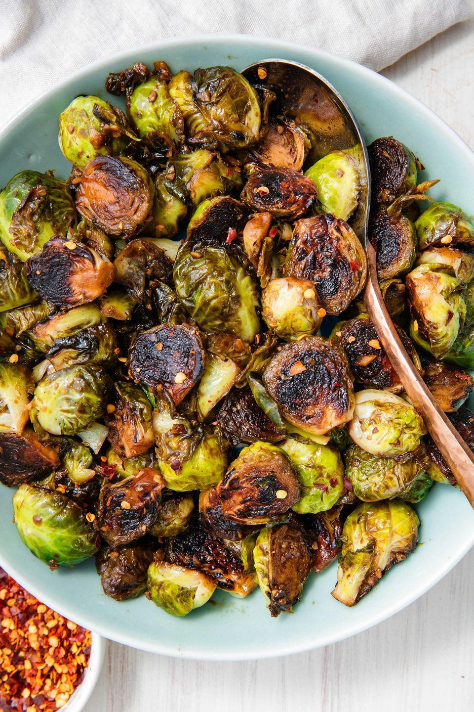 "<p>Add some veggies to the table in the most delicious way possible.</p><p>Get the recipe from <a href=""https://www.delish.com/holiday-recipes/thanksgiving/a23013160/honey-balsamic-glazed-brussels-sprouts-recipe/"" rel=""nofollow noopener"" target=""_blank"" data-ylk=""slk:Delish"" class=""link rapid-noclick-resp"">Delish</a>.</p>"
