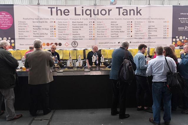 """<p>Hundreds of visitors sample 900 different real ales at """"The Liquor Tank"""" at the CAMRA Great British Beer Festival at Olympia London exhibition center on Aug. 8, 2017 (Photo: Ray Tang/REX/Shutterstock) </p>"""