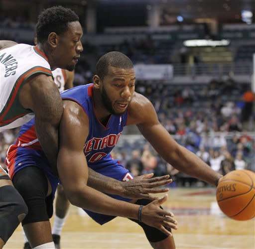 Detroit Pistons' Greg Monroe, right, drives to the basket against Milwaukee Bucks' Larry Sanders, left, during the first half of an NBA basketball game Monday, Jan. 30, 2012, in Milwaukee. (AP Photo/Jeffrey Phelps)