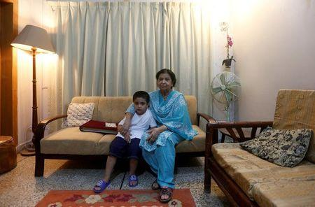 Rehana Khursheed Hashmi, 75, migrated from India with her family in 1960 and whose relatives, live in India, sits with her five year-old grandson Faraz Hashmi, at her residence in Karachi, Pakistan August 7, 2017. REUTERS/Akhtar Soomro
