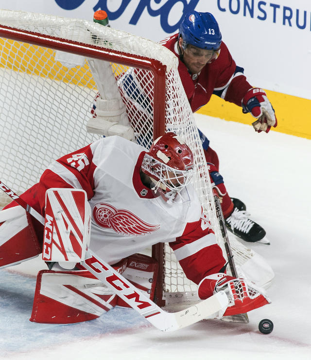 Montreal Canadiens' Max Domi moves in on Detroit Red Wings goaltender Jonathan Bernier during the second period of an NHL hockey game, Saturday, Dec. 14, 2019, in Montreal. (Graham Hughes/The Canadian Press via AP)