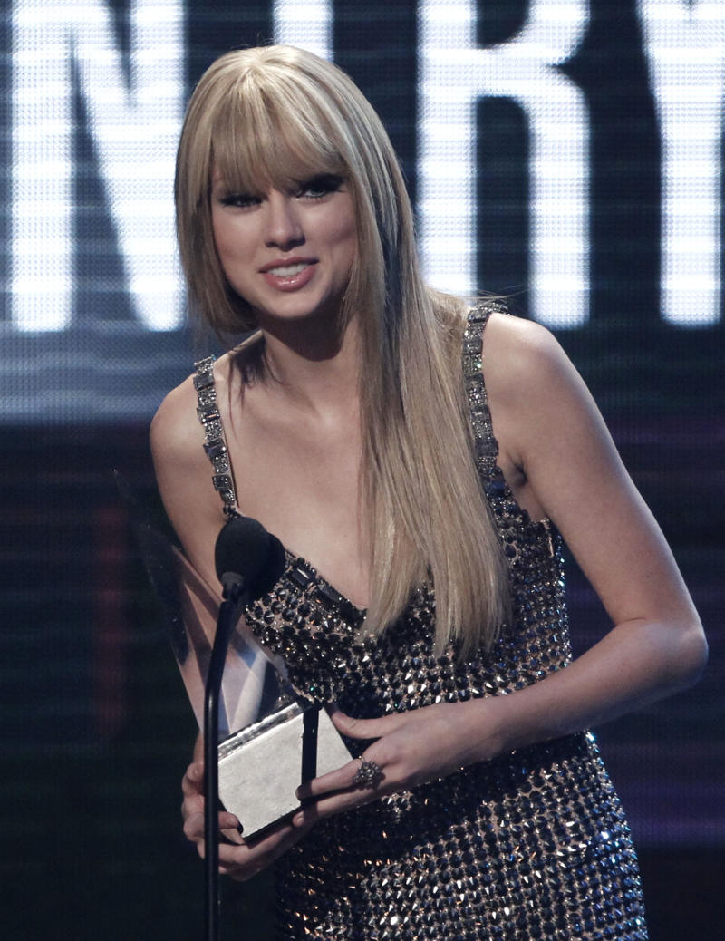 Taylor Swift accepts the award for country favorite female artist at the 38th Annual American Music Awards on Sunday, Nov. 21, 2010 in Los Angeles. (AP Photo/Matt Sayles)