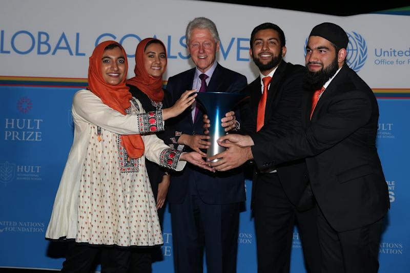Former President Bill Clinton poses with the 2017 Hult Prize winners. (Courtesy of the Hult Prize Foundation)