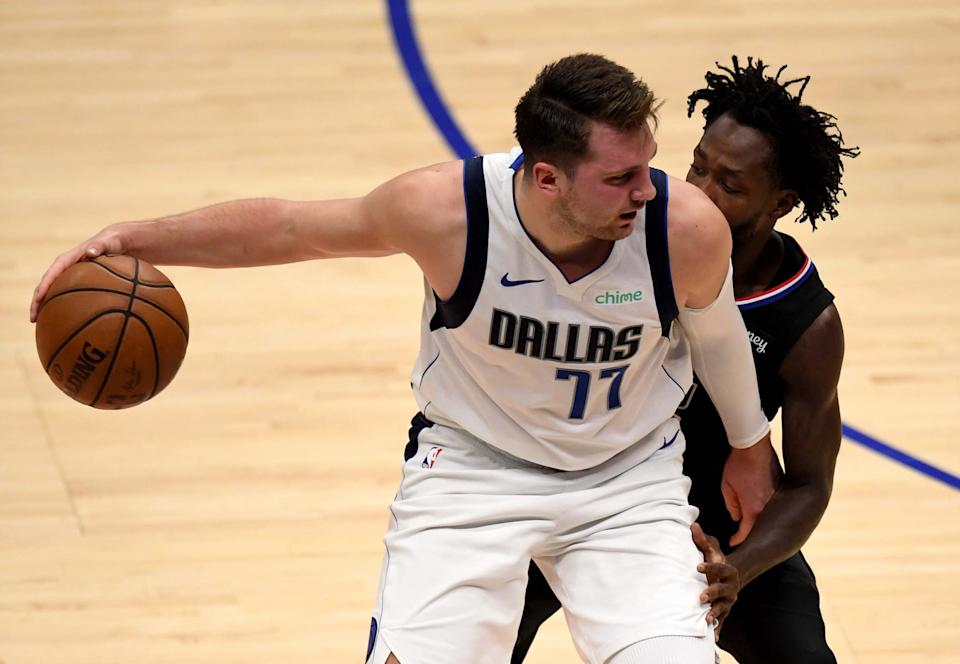 Luka Doncic controls the ball against Patrick Beverley.