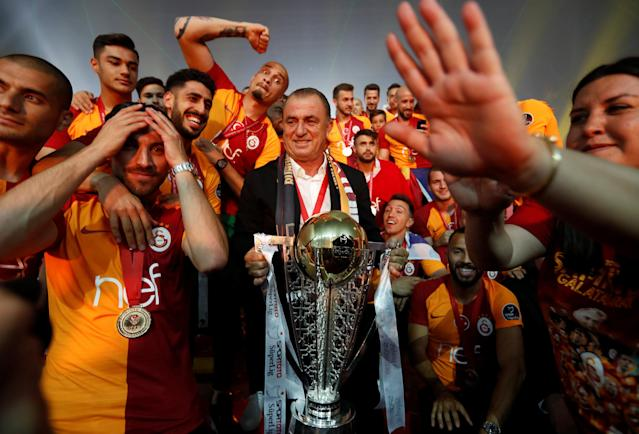 Soccer Football - Galatasaray Turkish Super League Trophy Presentation - Turk Telekom Arena, Istanbul, Turkey - May 20, 2018 Galatasaray coach Fatih Terim celebrates with the trophy and players REUTERS/Murad Sezer