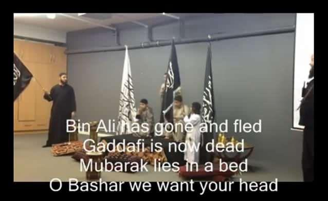 A chilling new video unearthed by 7News reveals young children calling an end to Australian democracy, for American President Barack Obama to 'go to hell' and for Syrian President Bashar al-Assad to be beheaded. Photo: 7News