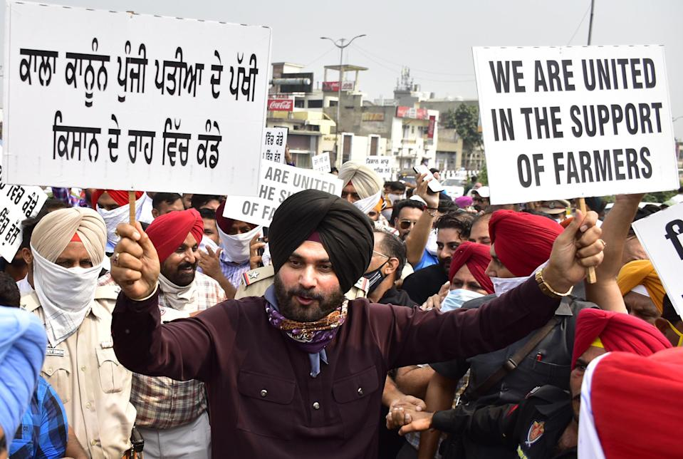 Congress leader Navjot Singh Sidhu along with his supporters march during a protest rally against the farm bills from Bhandari bridge to Hall gate on September 23, 2020 in Amritsar, India. (Photo by Sameer Sehgal/Hindustan Times via Getty Images)