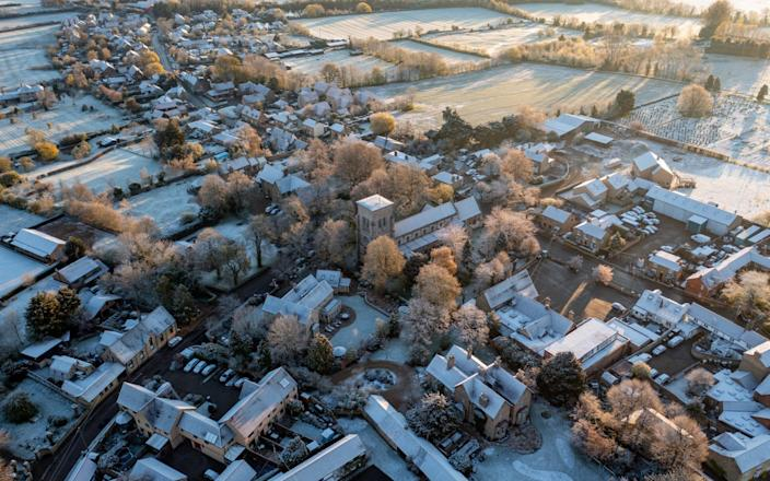 The village of Haddenham in Cambridgeshire woke up to a covering on snow on Monday morning - Geoff Robinson