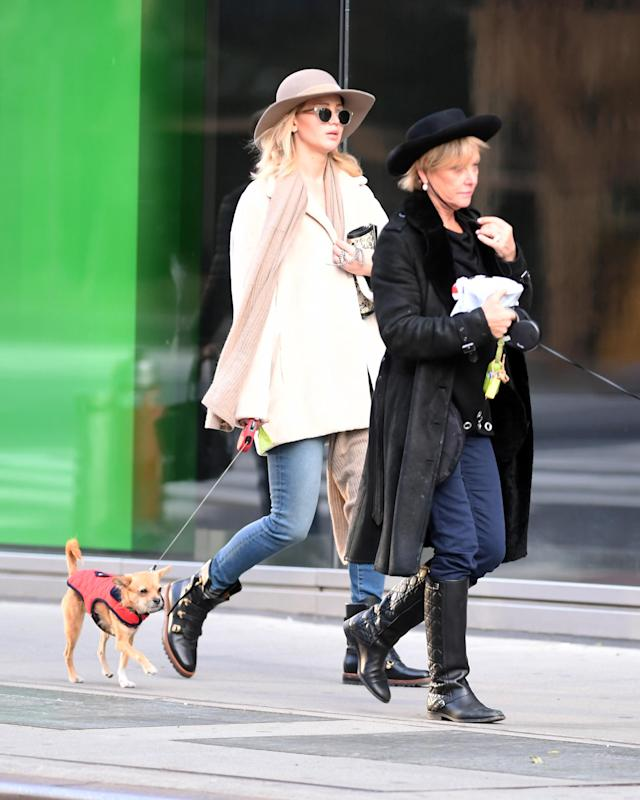 <p>J.Law and her mom, Karen, took a post-holiday stroll with their pups and strikingly similar ensembles in New York City. (Photo: Splash News) </p>