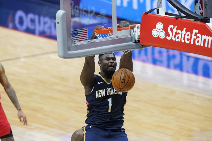 New Orleans Pelicans forward Zion Williamson (1) slam dunks in the second half of an NBA basketball game against the Portland Trail Blazers in New Orleans, Wednesday, Feb. 17, 2021. The Trail Blazers won 126-124. (AP Photo/Gerald Herbert)