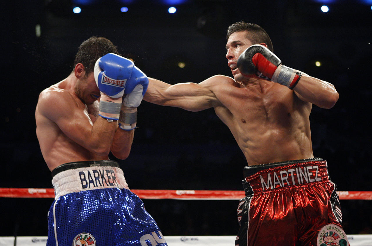 Sergio Martinez, of Oxnard, Calif., lands the final blow to knock out Darren Barker, of London, England, in the 11th round of WBC World Middleweight Diamond Belt Championship Bout in Atlantic City, N.J. on Saturday, Oct. 1, 2011. Martinez won by knockout in the 11th round. (AP Photo/Tim Larsen)