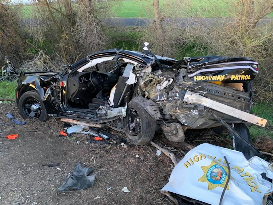A California Highway Patrol Vehicle was severely damaged and two officers injured when the car was struck from behind Tuesday morning. Three people in the other vehicle were killed.