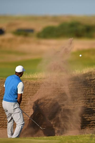 Tiger Woods spent a lot of time playing out of bunkers on the back nine on Thursday